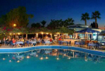 Enjoy your meals under the stars around the pool and close to the beach