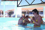 Relax with a drink at the pool bar of the Faros Hotel in Ayia Napa