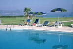 Relax by the swimming pool at the Natura Beach Hotel in Polis