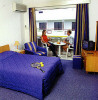 Petrou Bros Hotel Apartments bedroom, click to enlarge this photograph