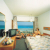 Vassos Nissi Plage Hotel Bedroom,click on this photograph to see a larger view